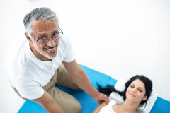 Doctor giving physiotherapy to pregnant woman Stock Photography