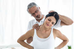Doctor giving physiotherapy to pregnant woman Royalty Free Stock Photo