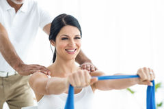 Doctor giving physiotherapy to pregnant woman Royalty Free Stock Images