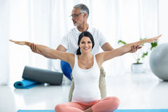 Doctor giving physiotherapy to pregnant woman Royalty Free Stock Image