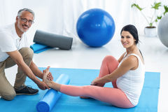 Doctor giving physiotherapy to pregnant woman Stock Photos