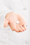 Doctor giving pill Royalty Free Stock Photography