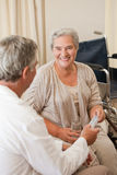 Doctor giving pills to his patient Stock Image