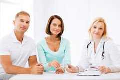 Doctor giving pills to patients Royalty Free Stock Image