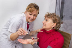 Doctor giving pills. To a pensioner Royalty Free Stock Images
