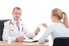 Doctor giving pills to young woman isolated on white Stock Photo