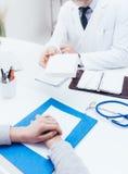 Doctor giving a prescription medicine Royalty Free Stock Photo