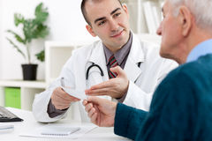 Doctor giving   a prescription Royalty Free Stock Images
