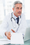 Doctor giving prescription to camera Stock Photos