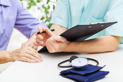 Doctor giving prescription Royalty Free Stock Image
