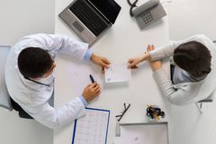 Doctor giving prescription to patient at hospital stock photography