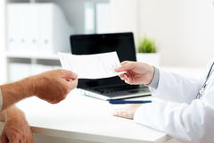 Doctor giving prescription to patient at hospital Royalty Free Stock Photo