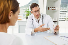 Doctor giving prescription to patient in medical office Stock Photo