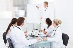 Doctor giving presentation to colleagues Royalty Free Stock Photography