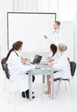 Doctor Giving Presentation To Colleagues Royalty Free Stock Photos