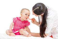 Doctor giving remedy to kid girl Royalty Free Stock Photo
