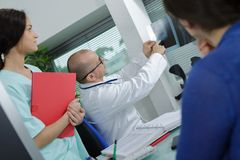 Doctor giving report to patient Stock Photography