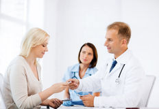 Doctor giving tablets to patient in hospital Stock Images