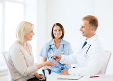 Doctor giving tablets to patient in hospital Royalty Free Stock Photo