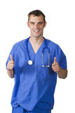 Doctor giving the thumbs up. A happy young doctor or nurse giving the thumbs up sign Royalty Free Stock Image