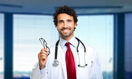 Doctor giving you a pair of eyeglasses Stock Photography