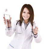 Doctor with glass of water and bottle. Stock Image