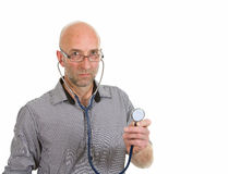Doctor with glasses holding stethoscope Stock Image