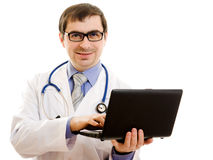The doctor in glasses with a laptop Royalty Free Stock Images