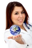 Doctor with a globe Stock Image