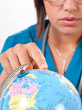Doctor and globe. Medical doctor with finger on the globe Royalty Free Stock Images