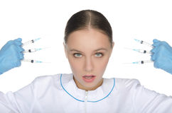 Doctor in gloves holding syringe front of face Royalty Free Stock Photos