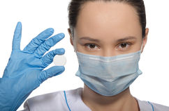 Doctor in gloves holds pill stock photography
