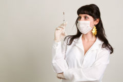 Doctor  in gloves showing ampule Royalty Free Stock Photography