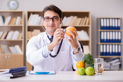 The doctor in gmo food concept Royalty Free Stock Images