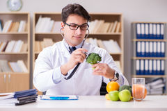The doctor in gmo food concept Stock Images