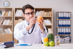 The doctor in gmo food concept Royalty Free Stock Photography