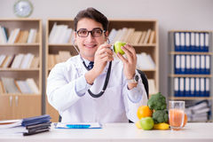 The doctor in gmo food concept Stock Photo