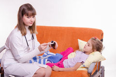 The doctor is going to give the medicine a sick child Stock Photos