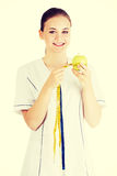 Doctor with a green apple and measuring tape. Stock Images