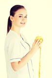 Doctor with a green apple and measuring tape. Royalty Free Stock Photo