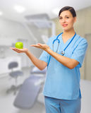 Doctor with green apple Stock Photos