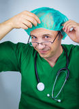Doctor in green uniform is preparing for operation Royalty Free Stock Photos