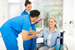 Doctor greeting patient Royalty Free Stock Images