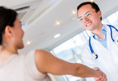 Doctor greeting a patient Royalty Free Stock Photography