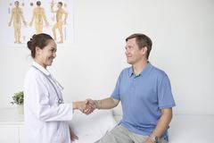 Doctor greeting patient royalty free stock photo