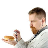 Doctor with hamburger Stock Photo