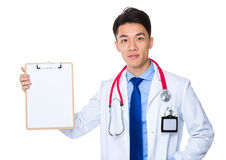Doctor hand dold with blank page of clipboard. Isolated on white background Royalty Free Stock Photo