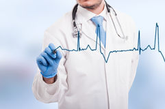 Doctor hand drawing chart electrocadiogram. Of ratio heartbeat on virtual screen royalty free stock photo