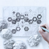 Doctor hand draws medical network on crumpled paper Royalty Free Stock Photos