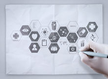 Doctor hand draws medical network on crumpled paper Royalty Free Stock Images